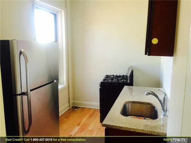 Photo of home for sale at 88-40 144th St, Jamaica NY