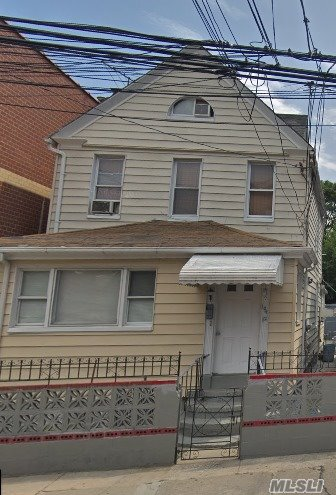 Photo of home for sale at 104-12 35th Ave, Flushing NY