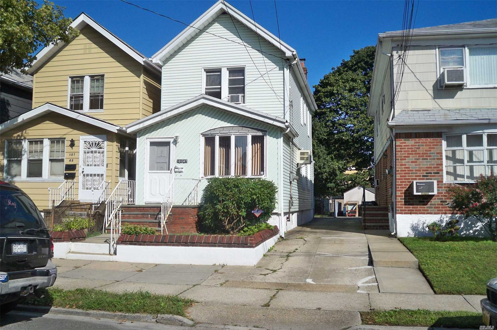 Photo of home for sale at 101-47 105th St, Ozone Park NY