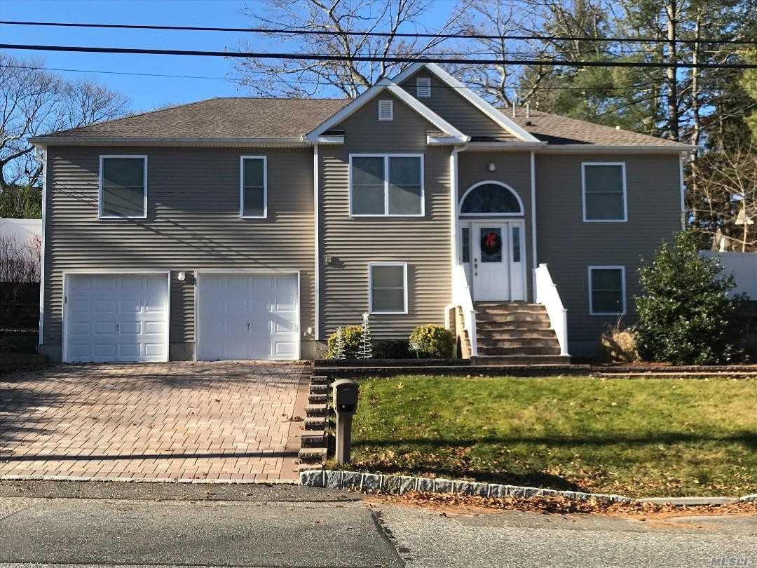 Photo of home for sale at 45 Norwood Ave, Selden NY