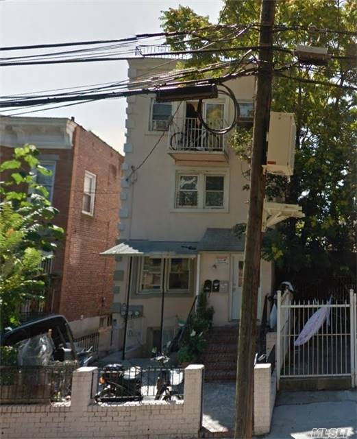 Photo of home for sale at 108-12 37th Dr, Corona NY