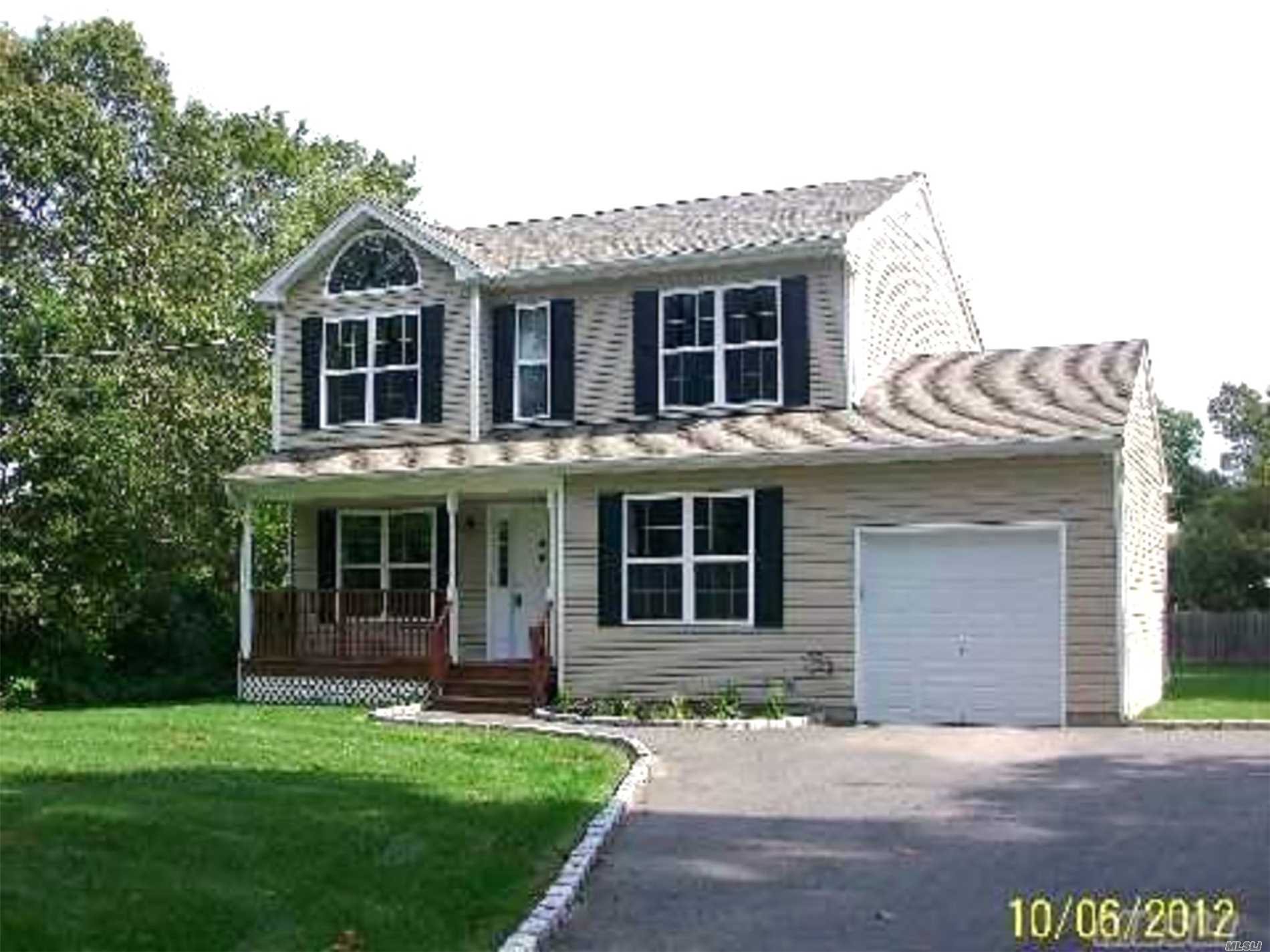 Photo of home for sale at 82A Oak St, Centereach NY