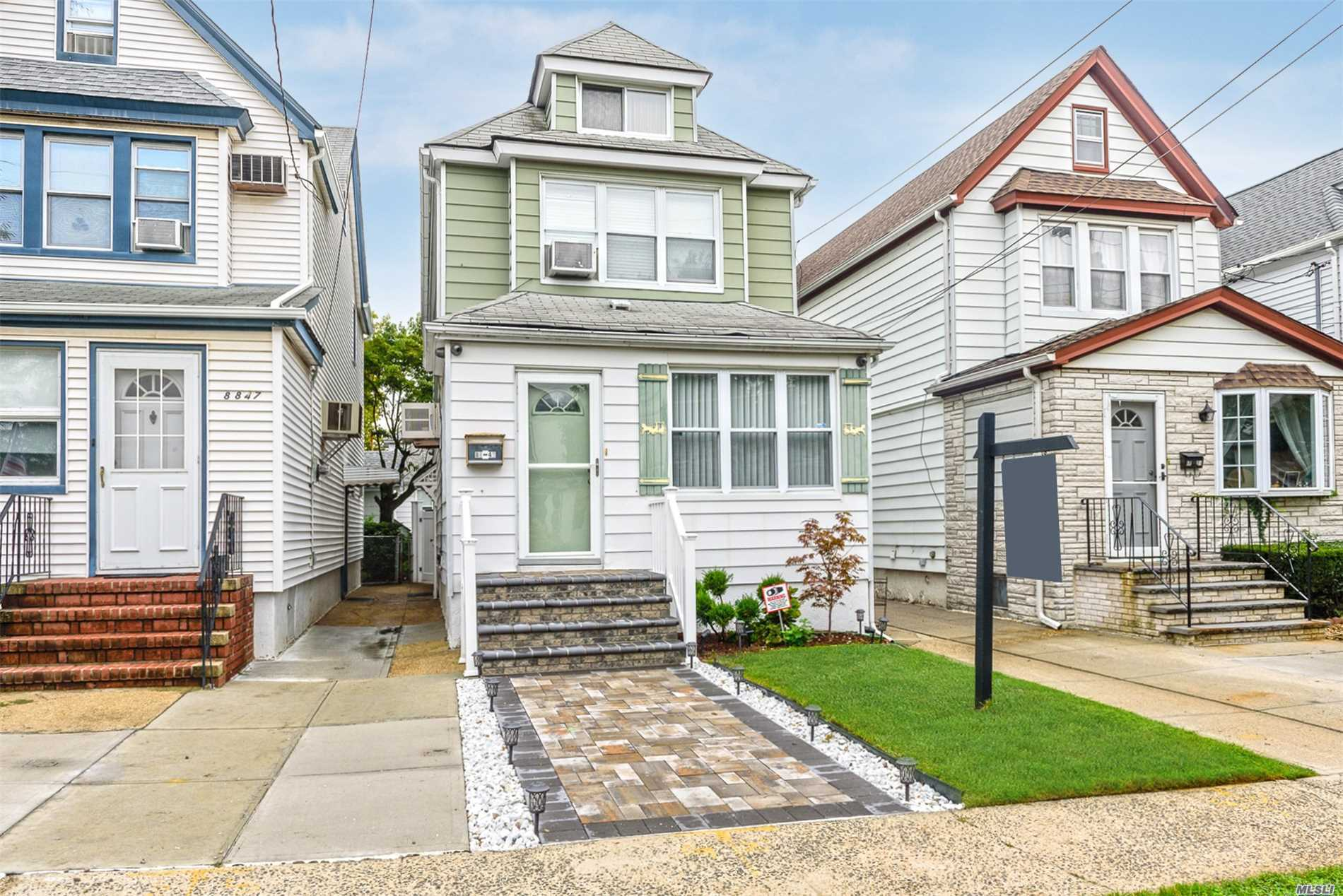 Photo of home for sale at 88-49 247 St, Bellerose NY