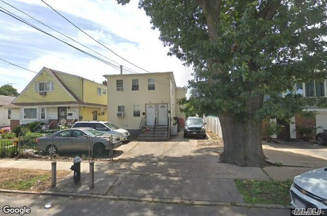 Photo of home for sale at 133-18 161st St, Jamaica NY