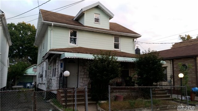 Photo of home for sale at 134-12 116th Ave, South Ozone Park NY