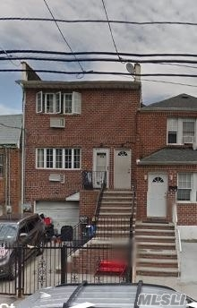 Photo of home for sale at 55-21 97th St, Corona NY