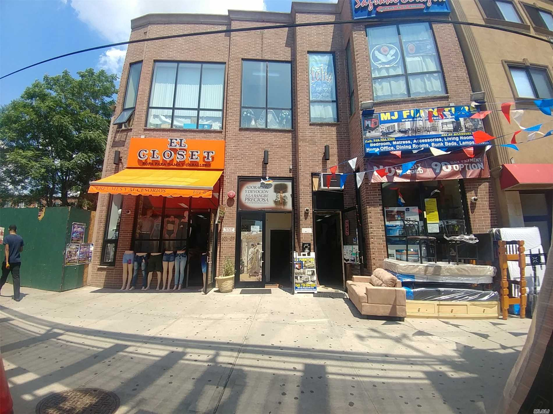 Photo of home for sale at 101-07 Roosevelt Ave, Corona NY