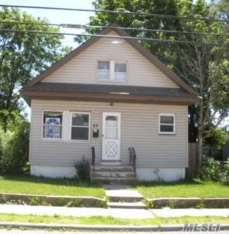 Photo of home for sale at 60 Washburn Ave, Freeport NY