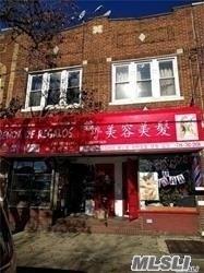 Photo of home for sale at 104-09 Corona Ave, Corona NY
