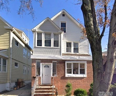 Photo of home for sale at 12-41 120th St, College Point NY