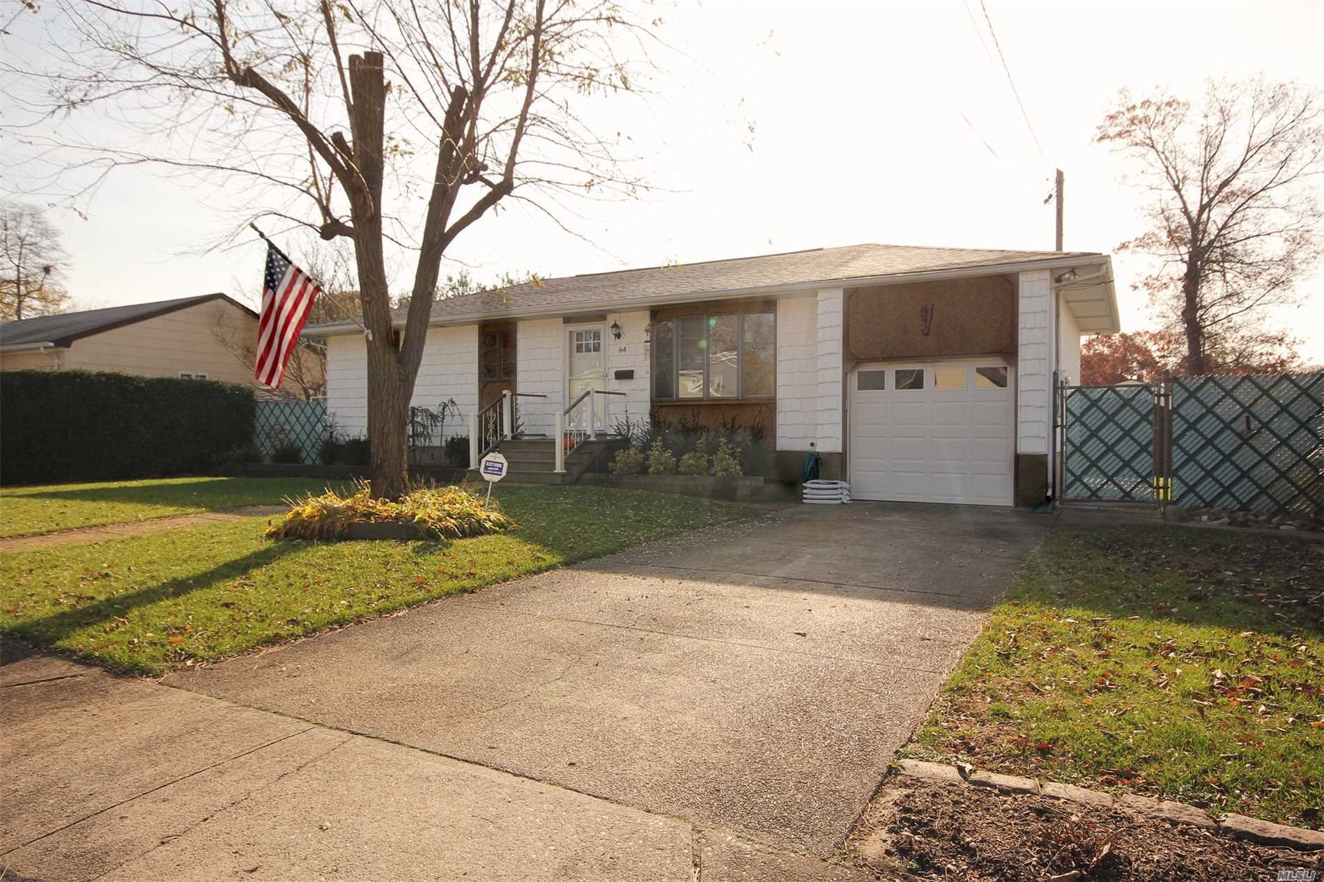 Photo of home for sale at 64 Danbury St, Bay Shore NY