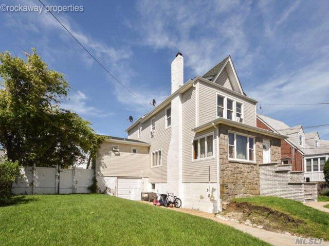 Photo of home for sale at 411 Beach 139 Street, Belle Harbor NY