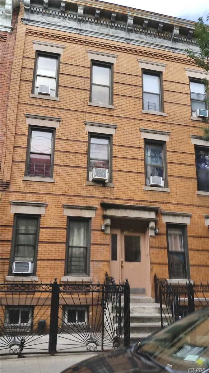 Photo of home for sale at 17-03 Palmetto St, Ridgewood NY