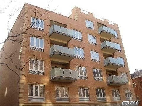 Photo of home for sale at 85-10 Elmhurst Ave, Elmhurst NY