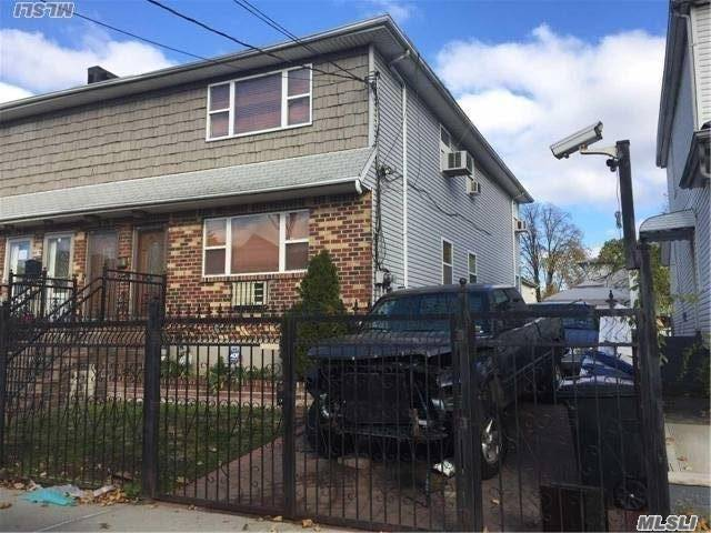 Photo of home for sale at 144-73 177th St, Jamaica NY
