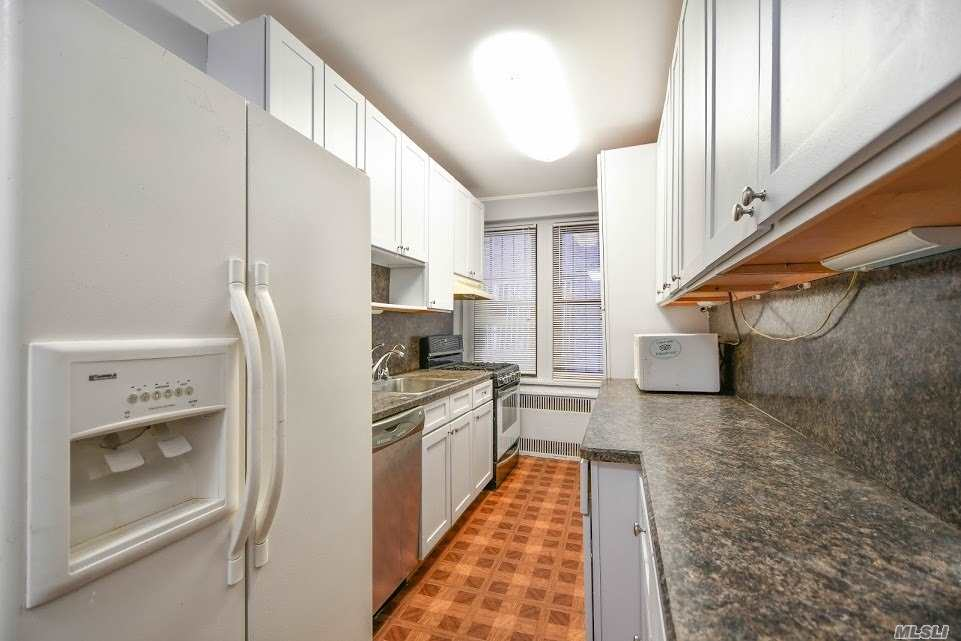 Photo of home for sale at 96-11 65th Rd, Rego Park NY
