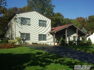 Photo of home for sale at 145 Sequoia Dr, Coram NY