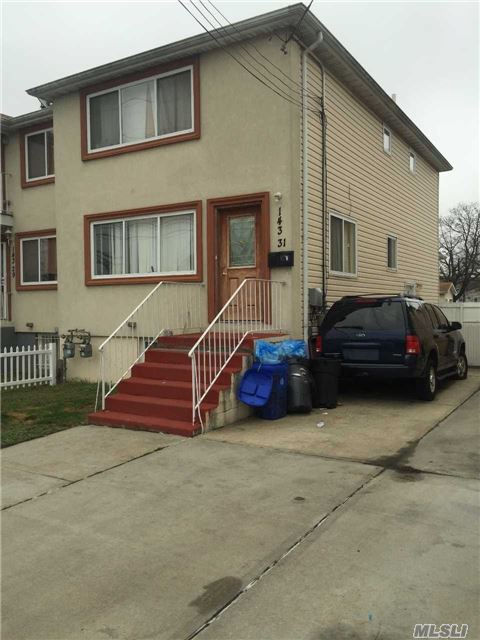 Photo of home for sale at 143-31 Farmers Blvd Blvd, Springfield Gdns NY
