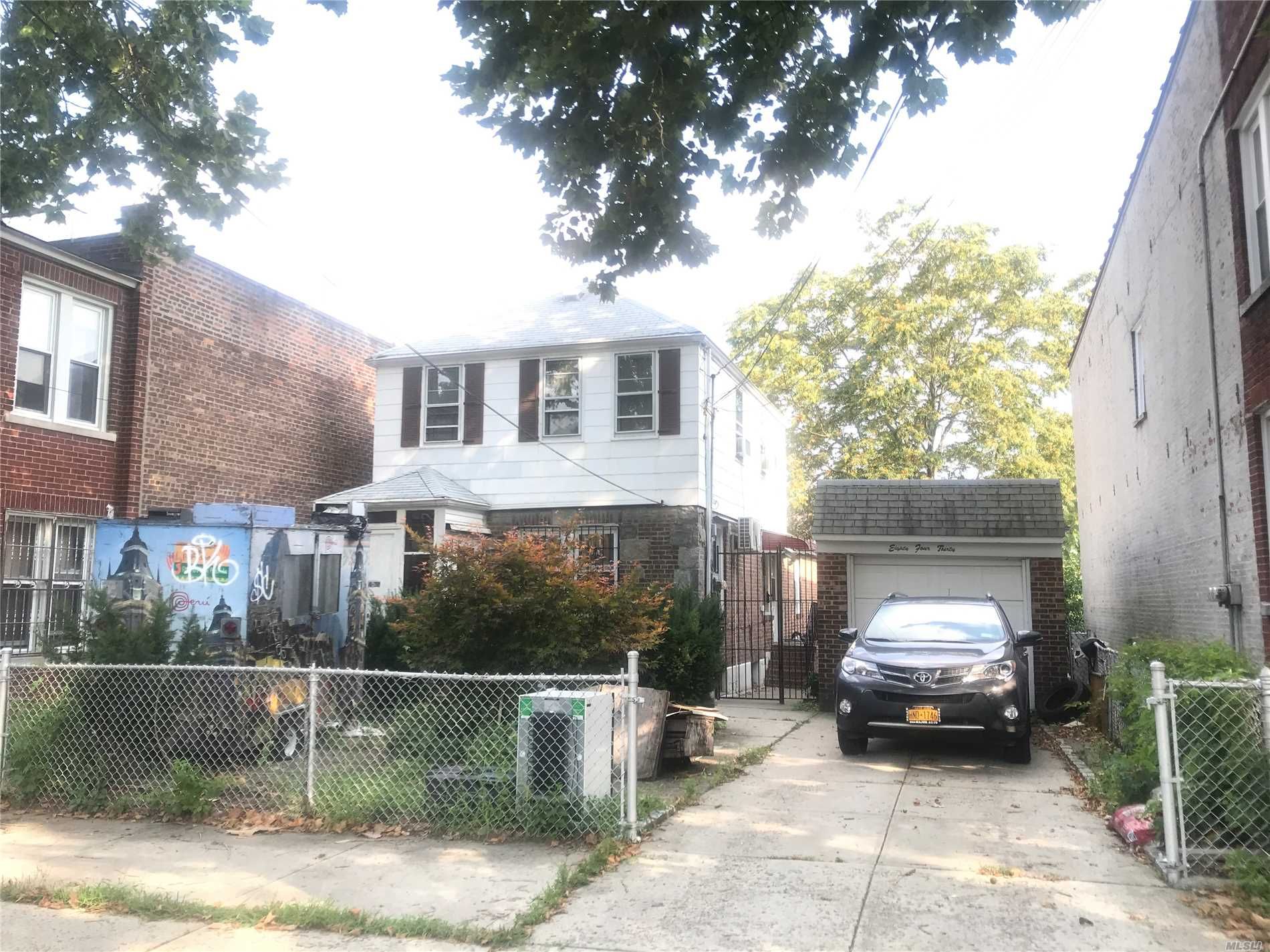 Photo of home for sale at 84-30 56th Ave, Elmhurst NY