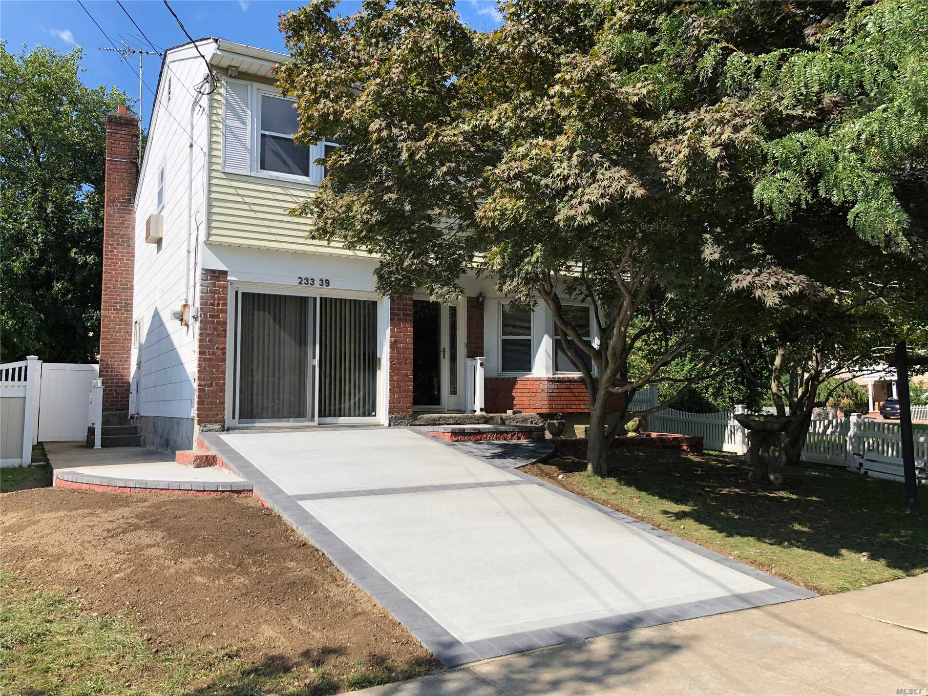 Photo of home for sale at 233-39 39 Ave, Douglaston NY