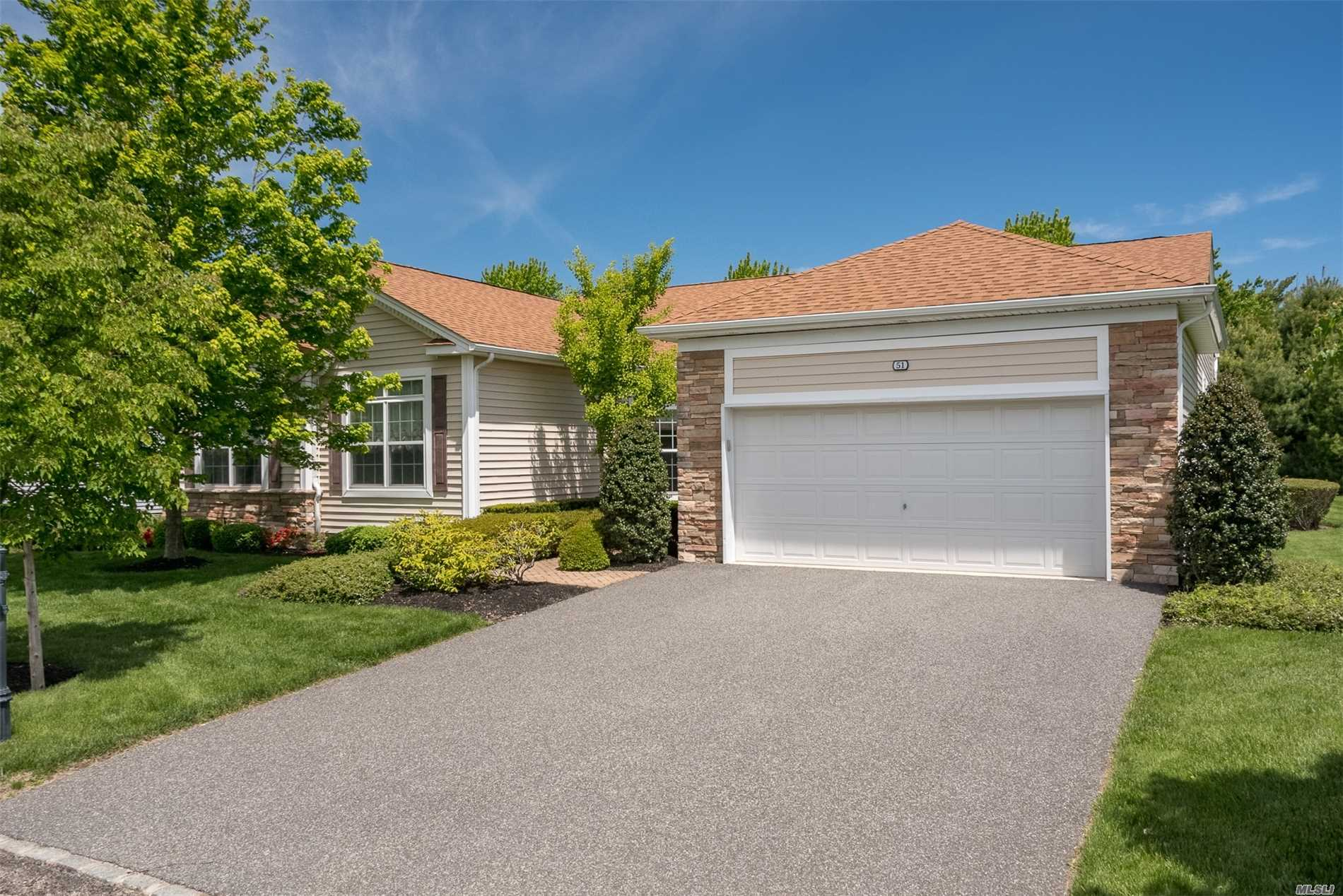 Photo of home for sale at 51 Hamlet Woods Dr, St. James NY
