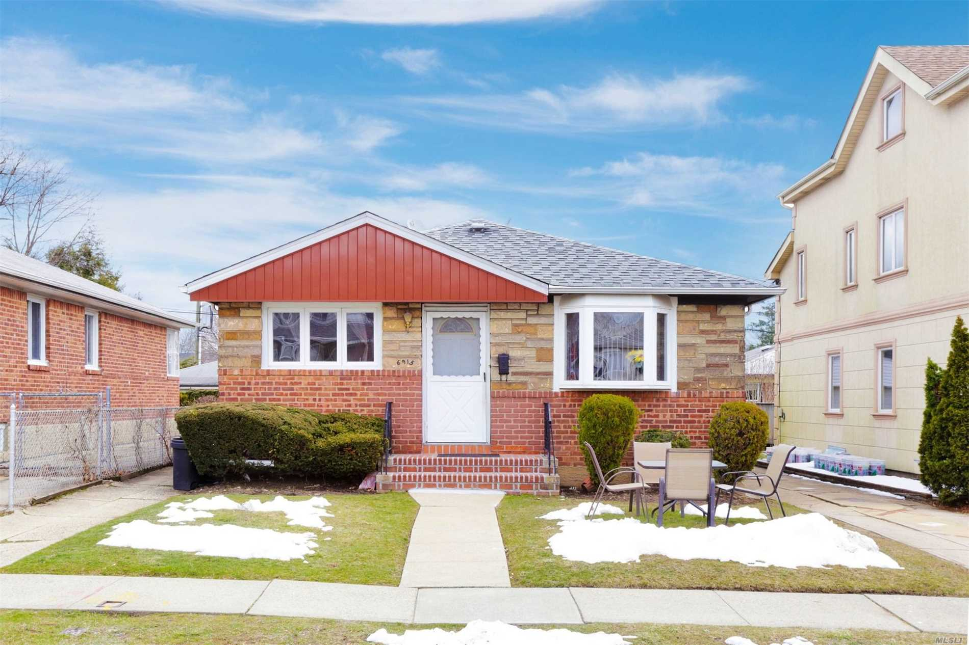 Photo of home for sale at 6915 169 St, Fresh Meadows NY