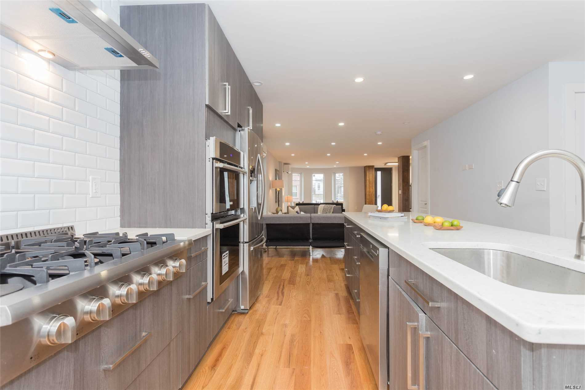 Photo of home for sale at 16-16 Norman St, Flushing NY