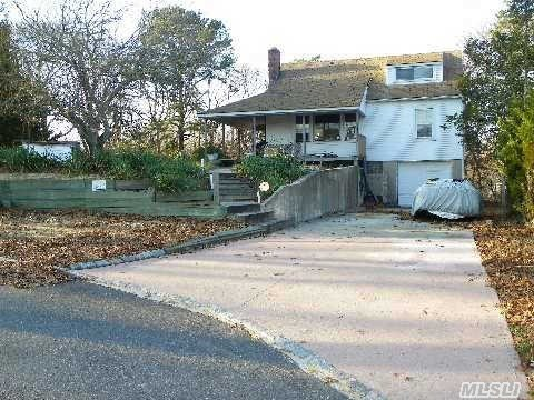 Photo of home for sale at 9 Bayview Dr, Hampton Bays NY