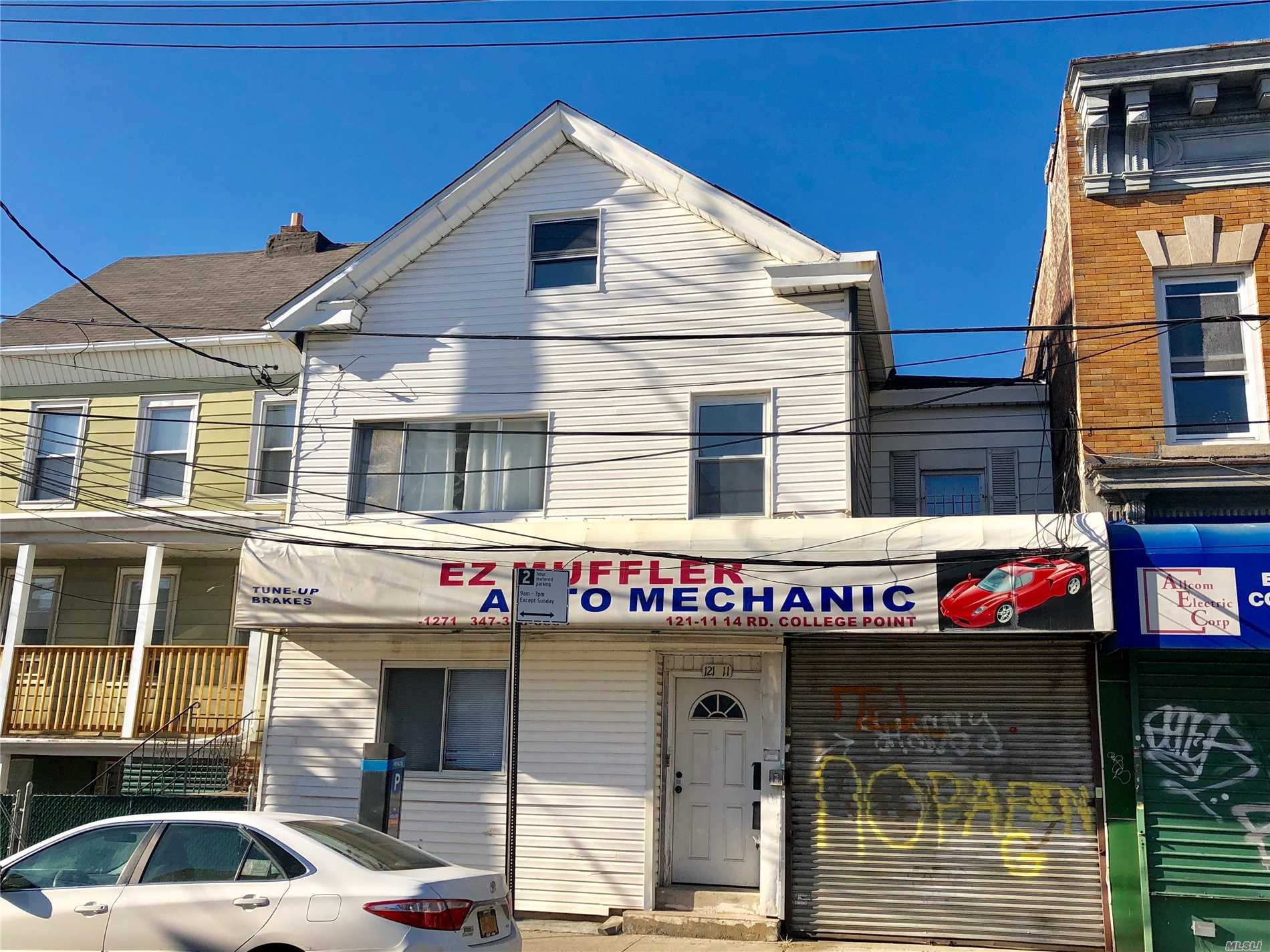 Photo of home for sale at 121-11 14 Rd, College Point NY
