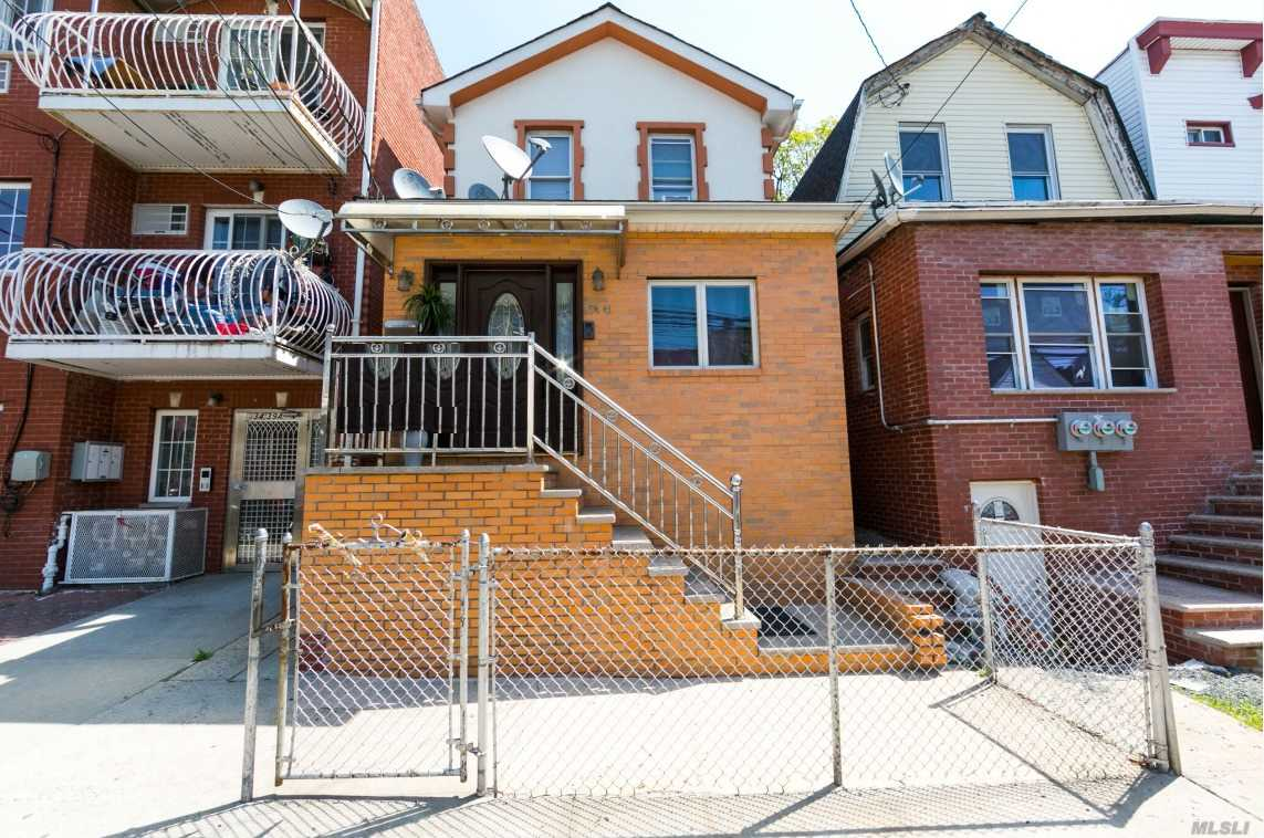 Photo of home for sale at 34-41 107 St, Corona NY