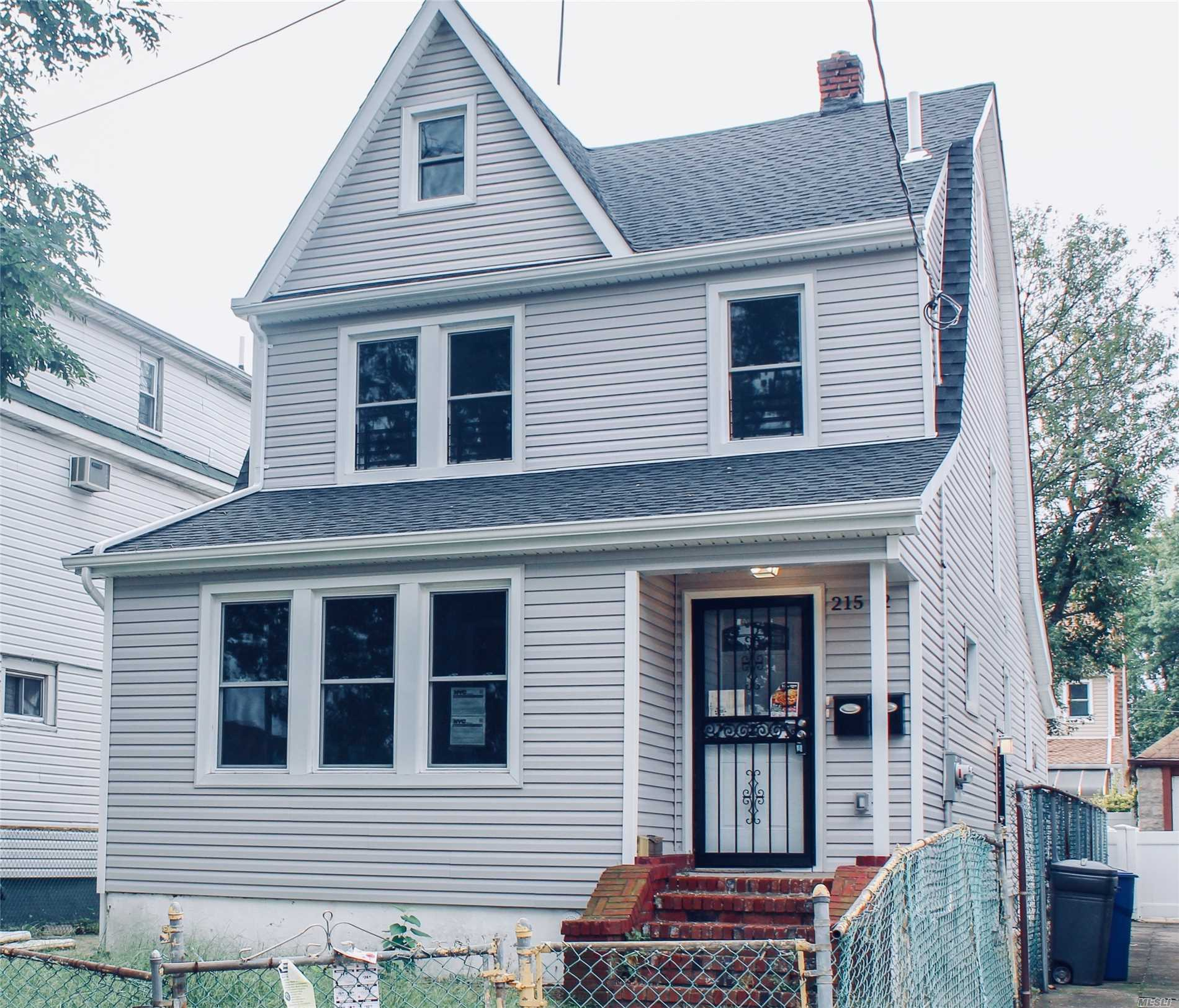 Photo of home for sale at 215-12 111Th Ave, Queens Village NY