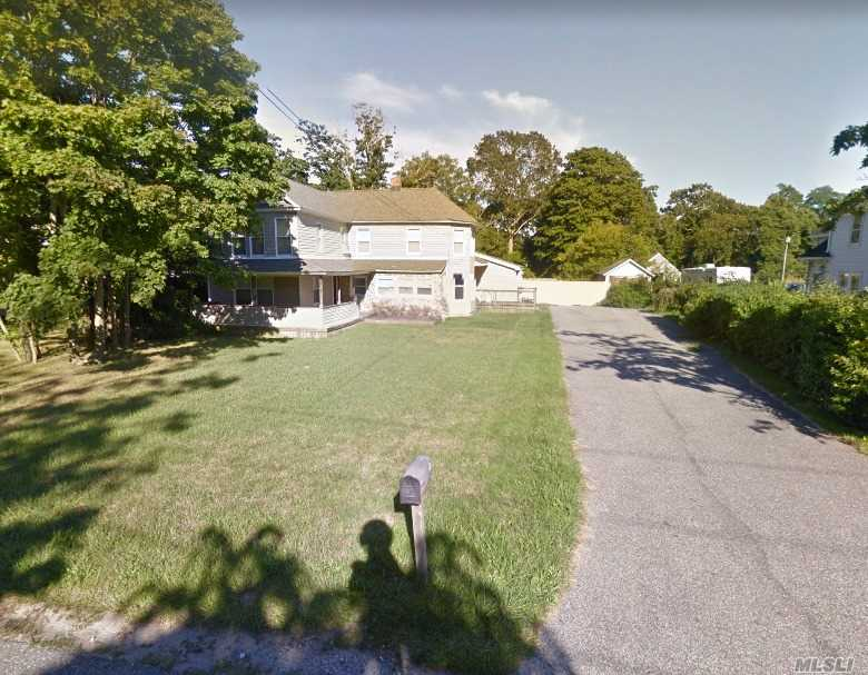 Photo of home for sale at 27 Chichester, Center Moriches NY