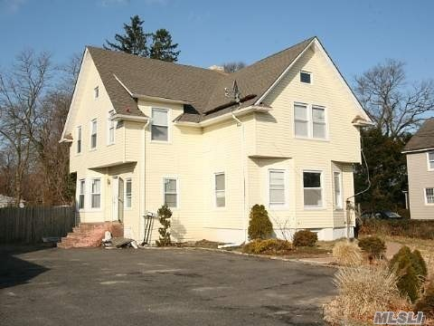 Photo of home for sale at 152 County Line Rd, Massapequa NY