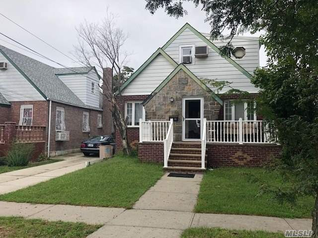 Photo of home for sale at 135-28 122nd St, South Ozone Park NY