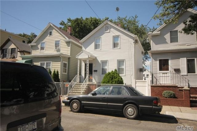 Photo of home for sale at 20-20 126 St, College Point NY