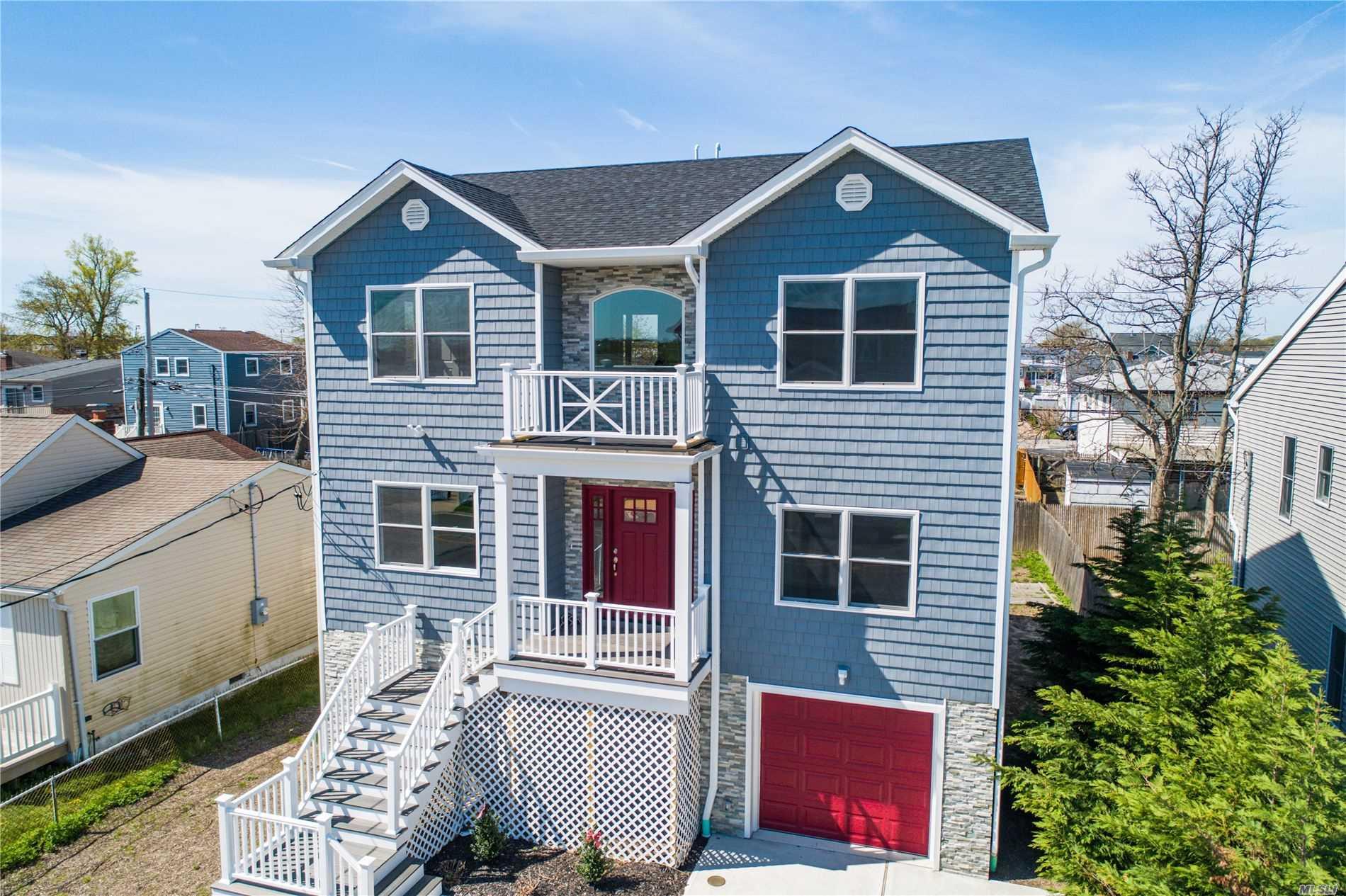 Photo of home for sale at 411 Venetian Blvd, Lindenhurst NY