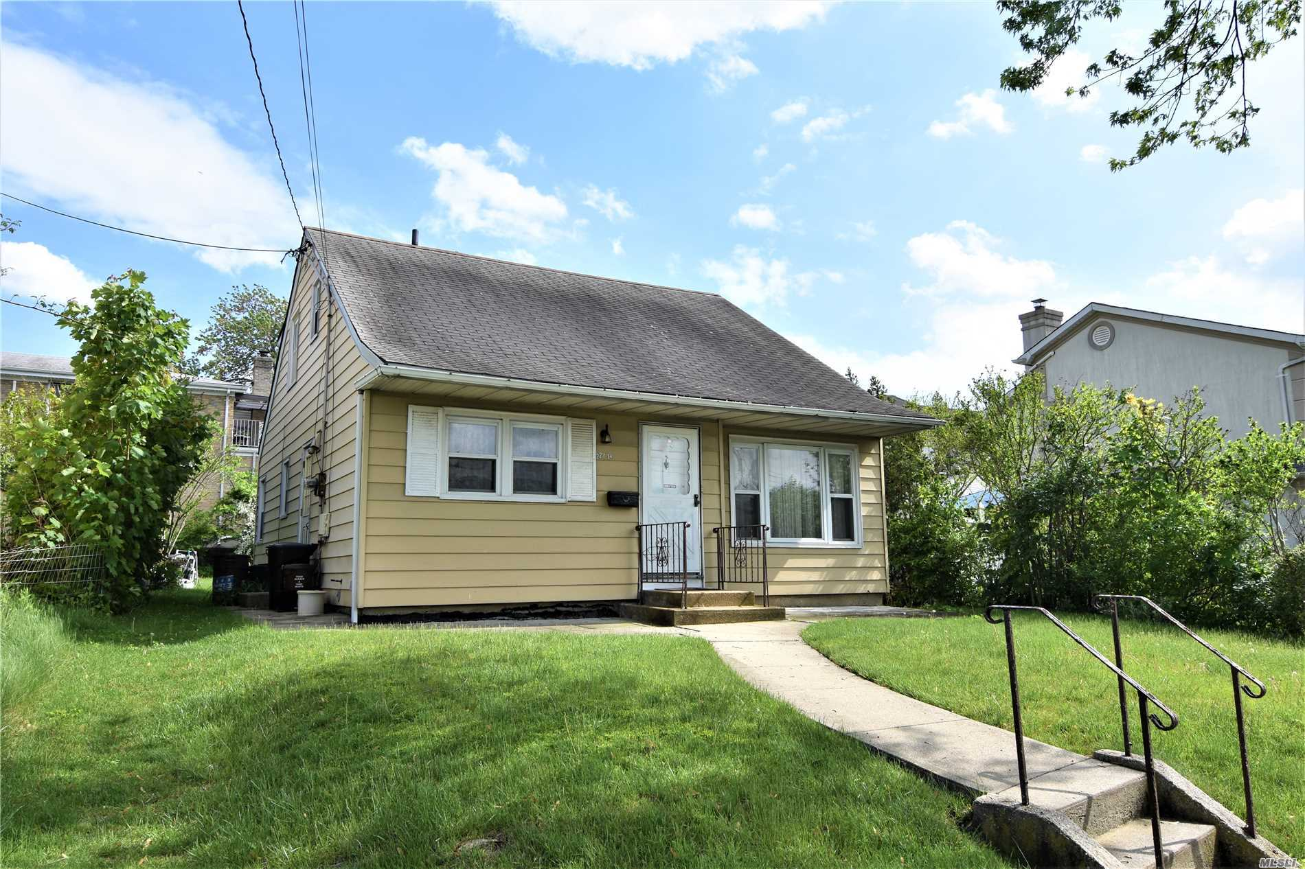 Photo of home for sale at 229-14 64 Ave, Bayside NY