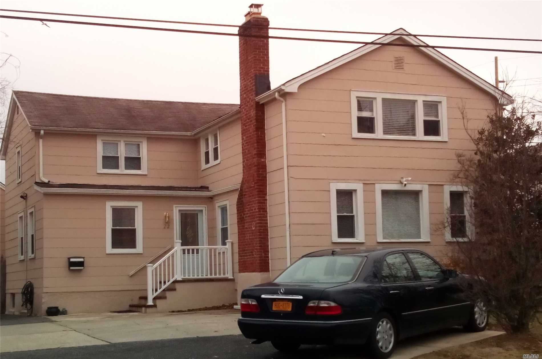 Photo of home for sale at 22 Montgomery Ave, West Babylon NY