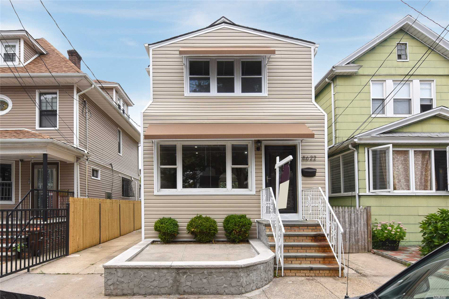 Photo of home for sale at 86-22 86th St, Woodhaven NY