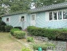 Photo of home for sale at 111 Woodside Ave W, Patchogue NY