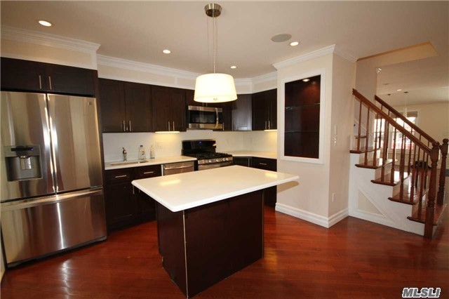 Photo of home for sale at 48-12 65th Pl, Woodside NY