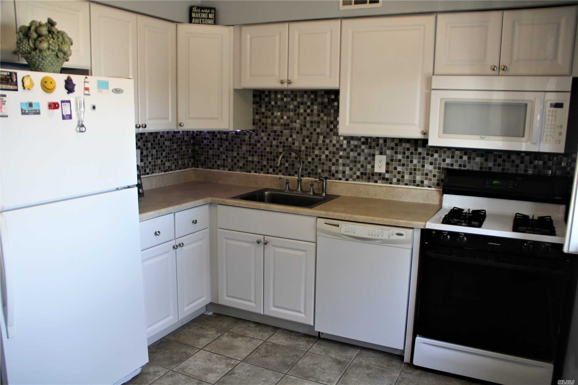 Photo of home for sale at 162 Pointe Circle N, Coram NY