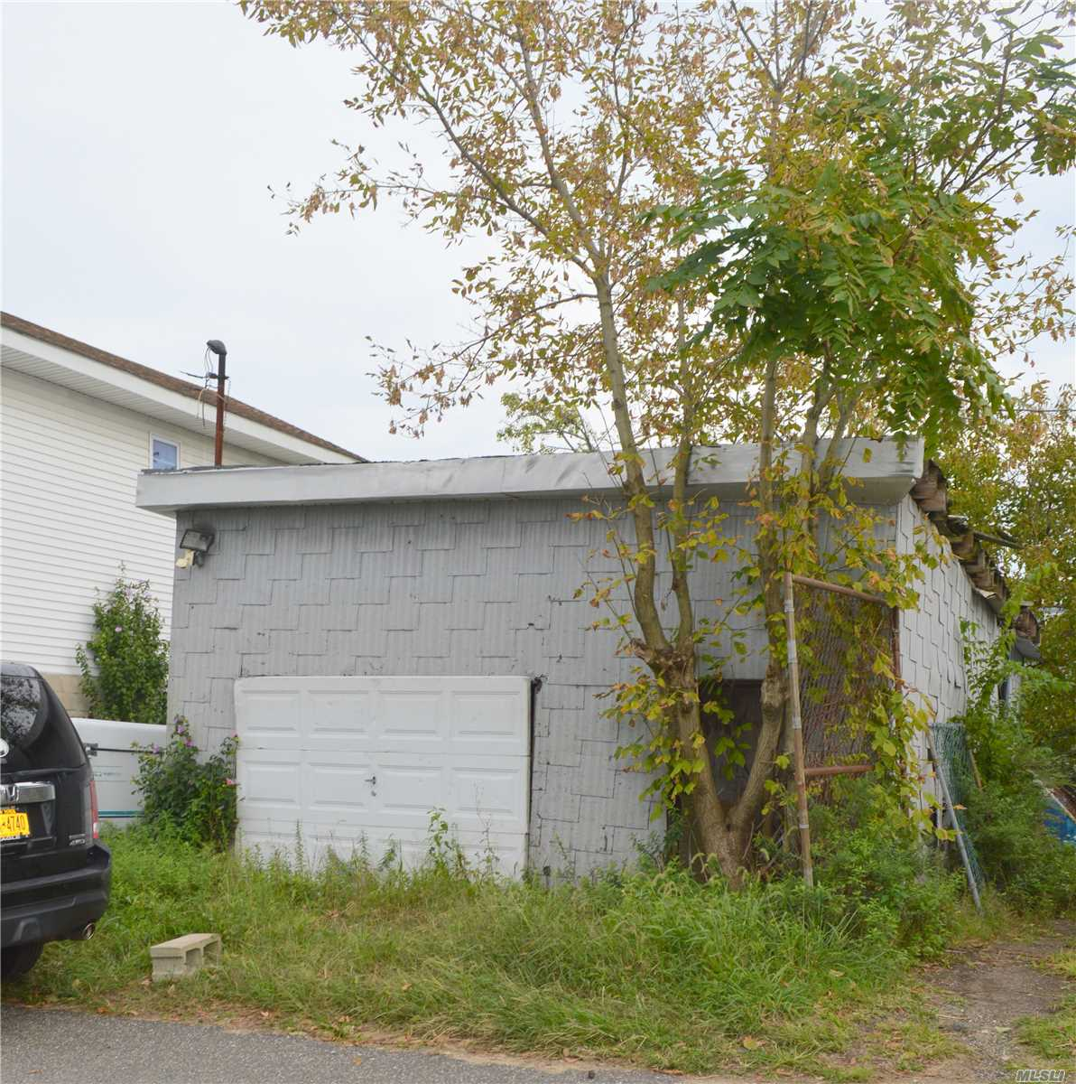 Photo of home for sale at 99-38 Russell St, Howard Beach NY