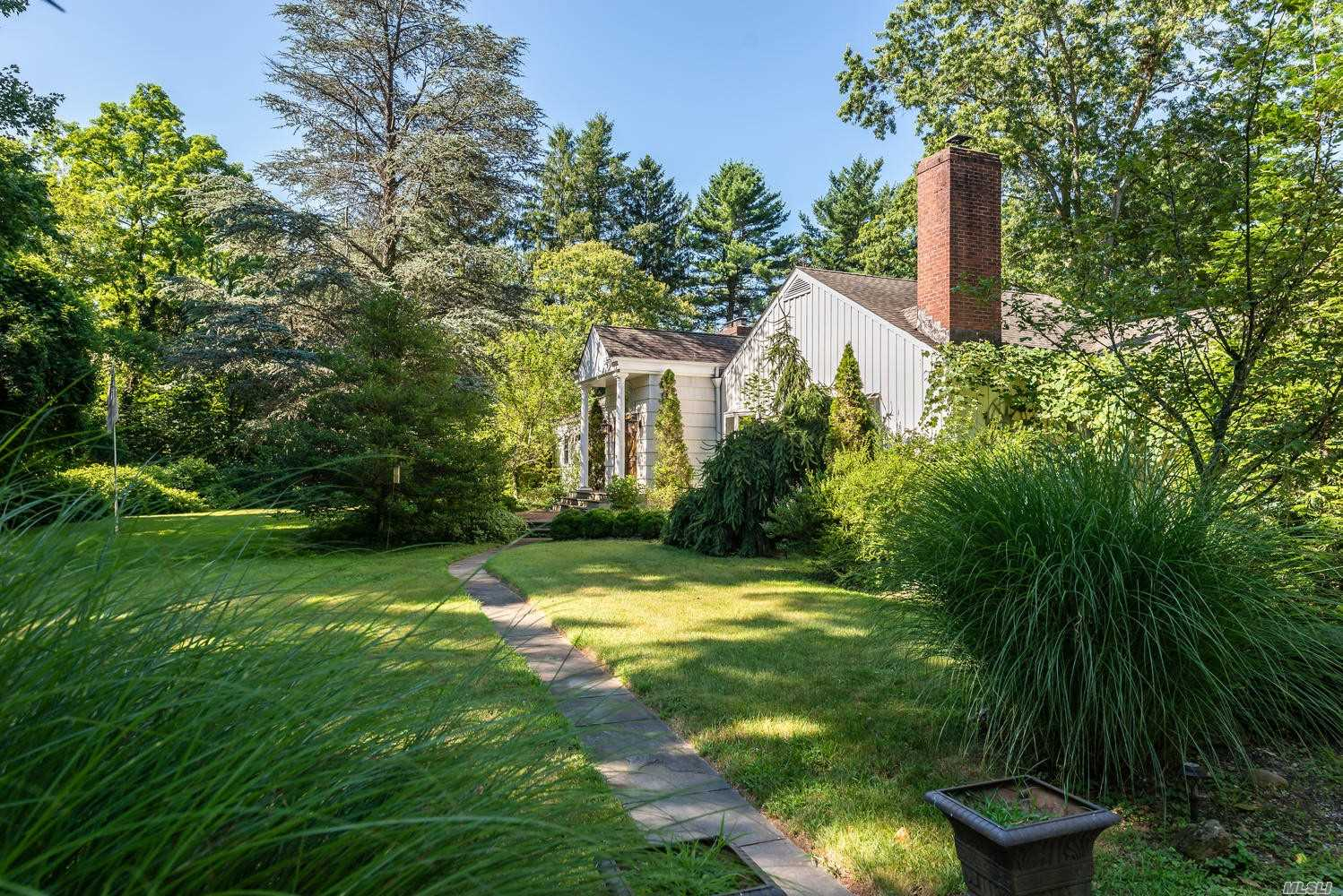 Photo of home for sale at 479 Woodbury Rd, Cold Spring Harbor NY
