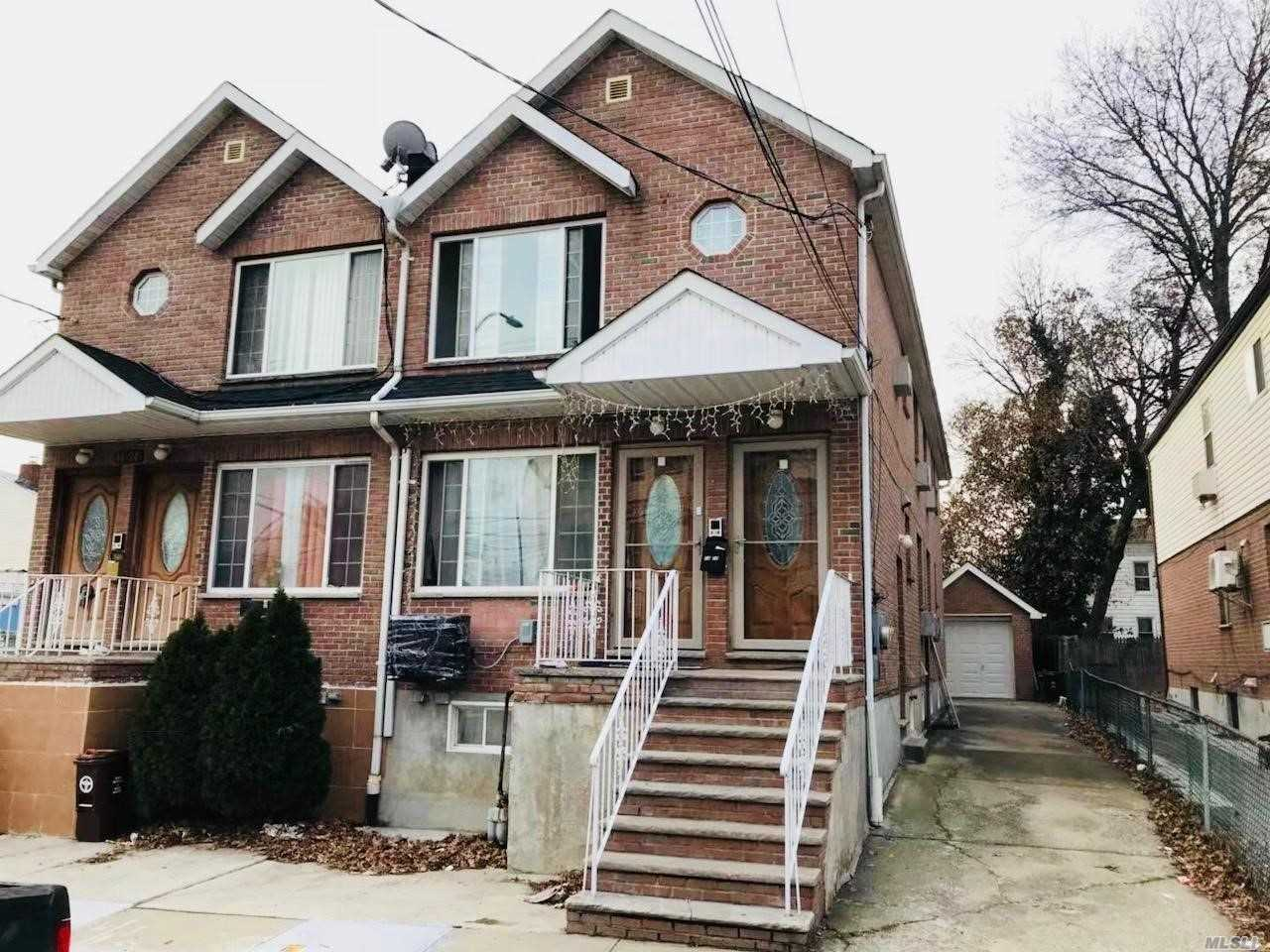 Photo of home for sale at 14-22 121 St, College Point NY