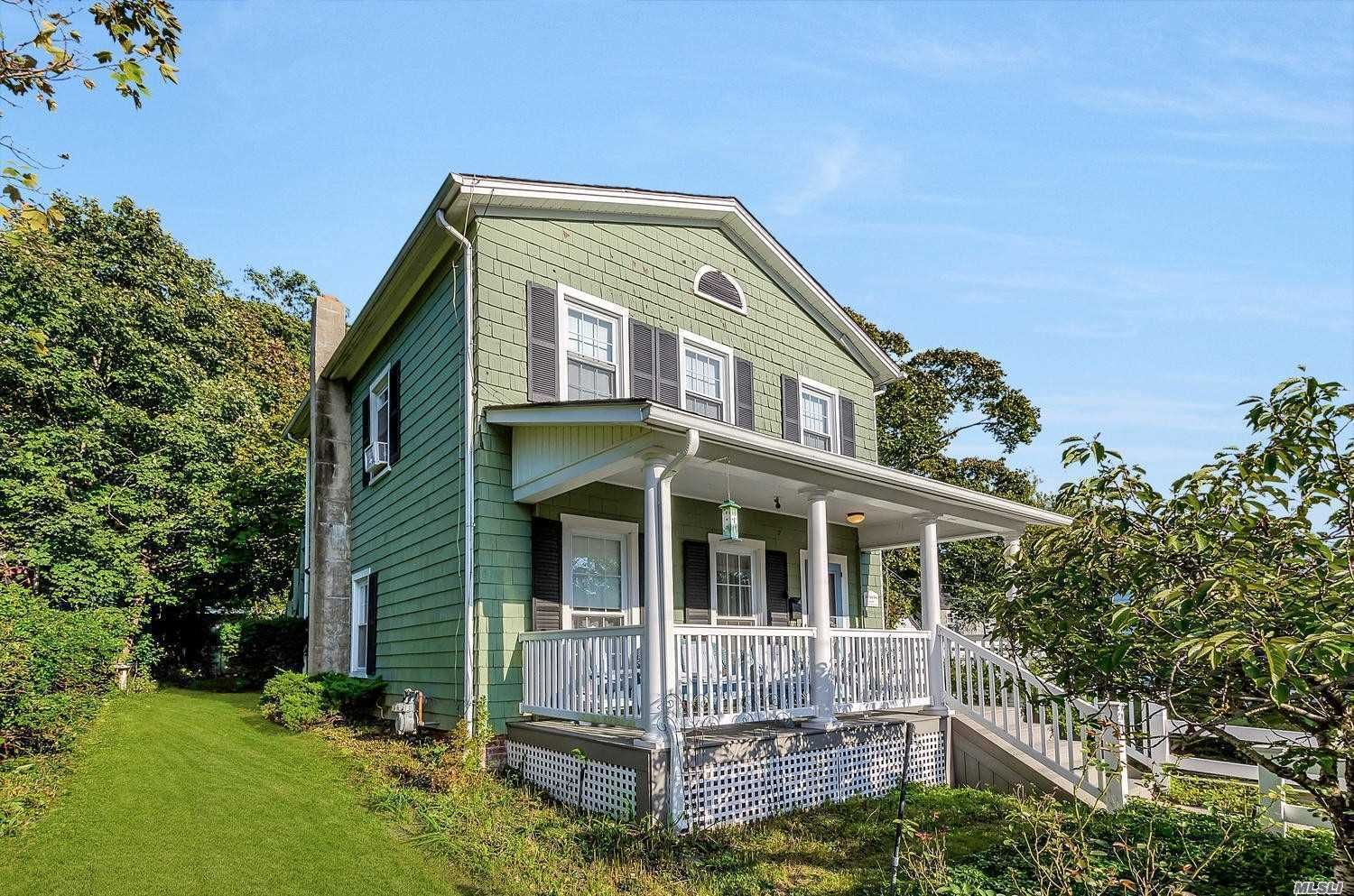 Photo of home for sale at 106 Division St, Port Jefferson NY
