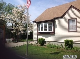 Photo of home for sale at 87-14 239th St, Bellerose NY