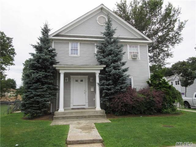 Photo of home for sale at 716 Prospect Ave, Westbury NY