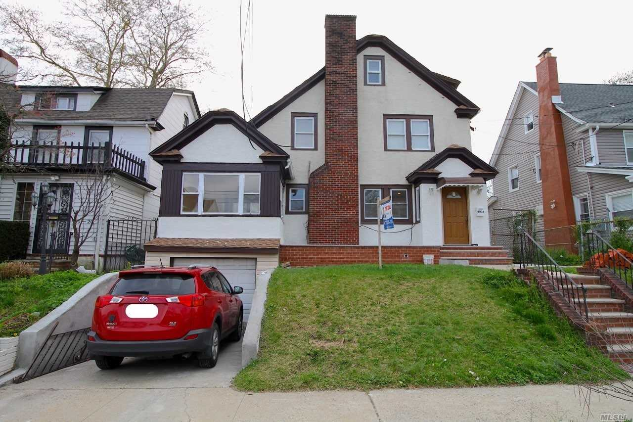 Photo of home for sale at 99-16 191st St, Jamaica NY