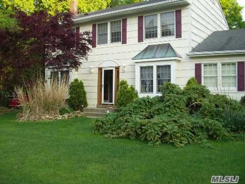 Photo of home for sale at 8 Woods Dr, Pt.Jefferson Sta NY